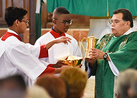 Deacon Jose Aragon with altar servers